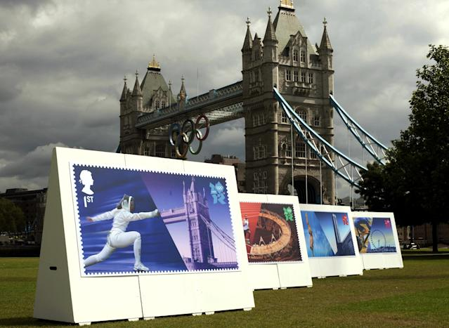 <p> Enlarged images of Royal Mail's Welcome to the London 2012 Olympics stamps are displayed at Potters Fields, London on Monday July 23, 2012. The postal service says it will issue a stamp honoring every member of Team GB who wins a gold medal during the games. It is promising to have them on sale within 24 hours of the athlete's victory. (AP Photo/David Parry, PA) UNITED KINGDOM OUT; NO SALES; NO ARCHIVE </p>
