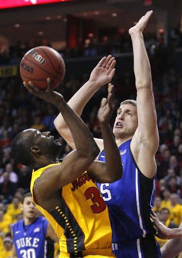Maryland forward James Padgett, left, attempts to shoot over Duke forward Mason Plumlee in the first half of an NCAA college basketball game in College Park, Md., Wednesday, Jan. 25, 2012. (AP Photo/Patrick Semansky)