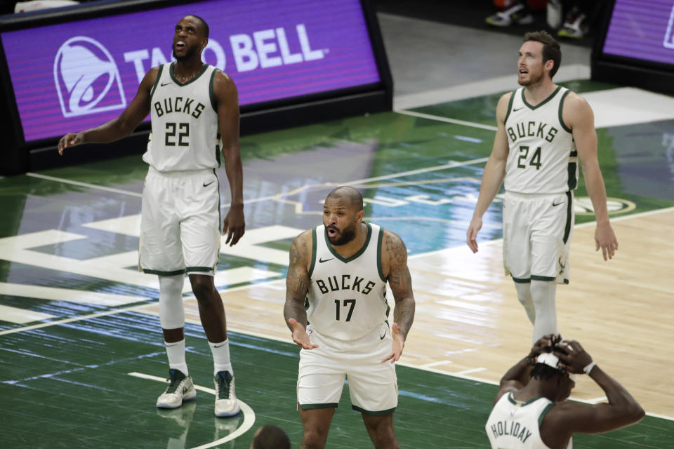 Milwaukee Bucks' P.J. Tucker (17) and teammates reacts to a foul call during the first half of the team's NBA basketball game against the Philadelphia 76ers on Thursday, April 22, 2021, in Milwaukee. (AP Photo/Aaron Gash)