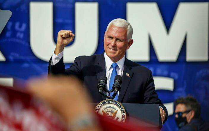 """It's great to be back in the Sunshine State, it's great to be back in Trump country,"" Mr Pence said as he took to the stage in Brownwood Paddock Square.  - AFP"