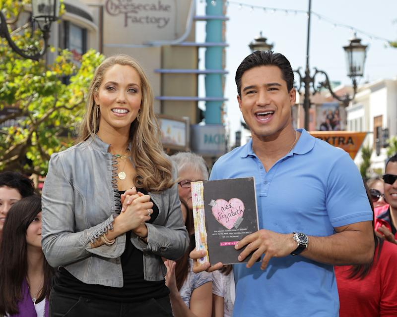 LOS ANGELES, CA - APRIL 04: Elizabeth Berkley (L) and Mario Lopez visit Extra at The Grove on April 4, 2011 in Los Angeles, California. (Photo by Noel Vasquez/Getty Images for Extra)