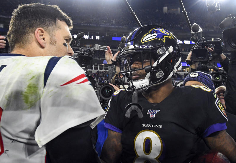 Tom Brady, left, told Lamar Jackson he's a big fan of the young quarterback's play. (Mark Goldman/Getty Images)