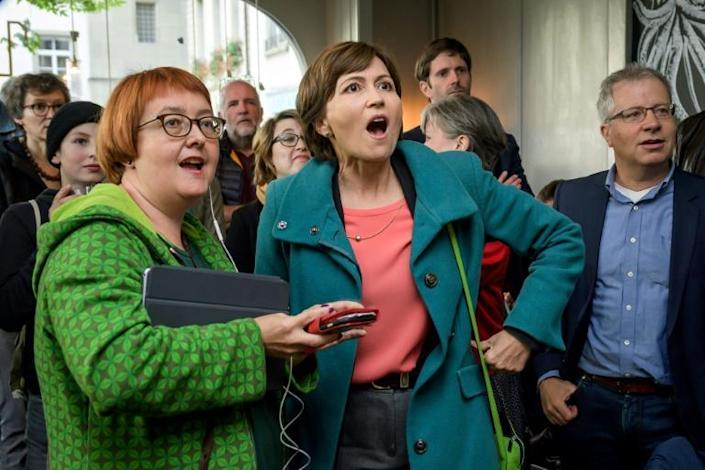 """Green Party president Regula Rytz, centre, said the results marked a """"tectonic shift"""" (AFP Photo/FABRICE COFFRINI)"""