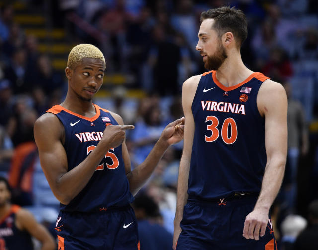 Mamadi Diakite (L) jokes with teammate Jay Huff of the Virginia Cavaliers during the second half of their game against the North Carolina Tar Heels on Feb. 15. (Grant Halverson/Getty Images)
