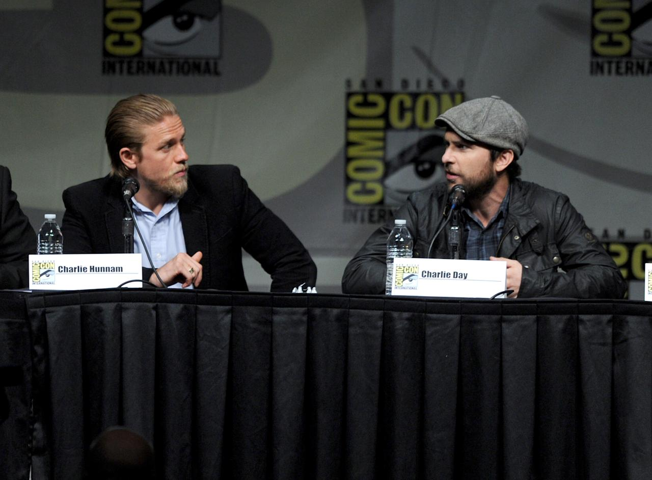 """SAN DIEGO, CA - JULY 14:  Actors Charlie Hunnam (L) and Charlie Day speak at Warner Bros. Pictures and Legendary Pictures Preview of """"Pacific Rim"""" during Comic-Con International 2012 at San Diego Convention Center on July 14, 2012 in San Diego, California.  (Photo by Kevin Winter/Getty Images)"""