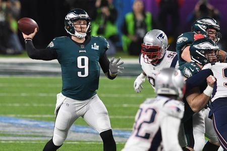 Feb 4, 2018; Minneapolis, MN, USA; Philadelphia Eagles quarterback Nick Foles (9) throws the ball against the New England Patriots during the third quarter in Super Bowl LII at U.S. Bank Stadium. Mandatory Credit: John David Mercer-USA TODAY Sports