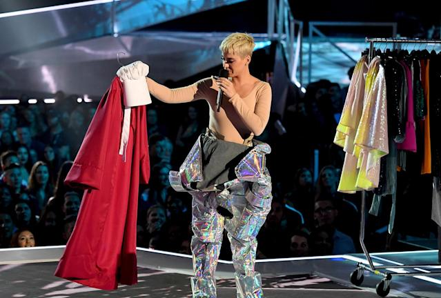 <p>Host Katy Perry regards the <em>Handmaid's Tale</em> costume at the VMAs. (Photo: Kevin Winter/Getty Images) </p>