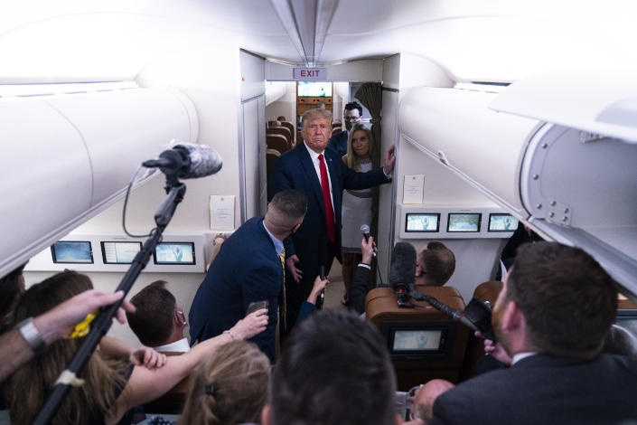 President Donald Trump talks with reporters after leaving a campaign rally at Pensacola International Airport, Friday, Oct. 23, 2020, aboard Air Force One. (AP Photo/Evan Vucci)