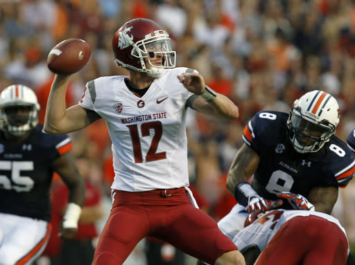 Washington State quarterback Connor Halliday (12) looks to throw against Auburn during the second quarter of an NCAA college football game against Washington State on Saturday, Aug. 31, 2013, in Auburn, Ala. (AP Photo/Butch Dill)