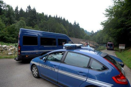 "Vehicles of French gendarmerie drive on the ""Combe d'Ire"" road in the French Alpine village of Chevaline"