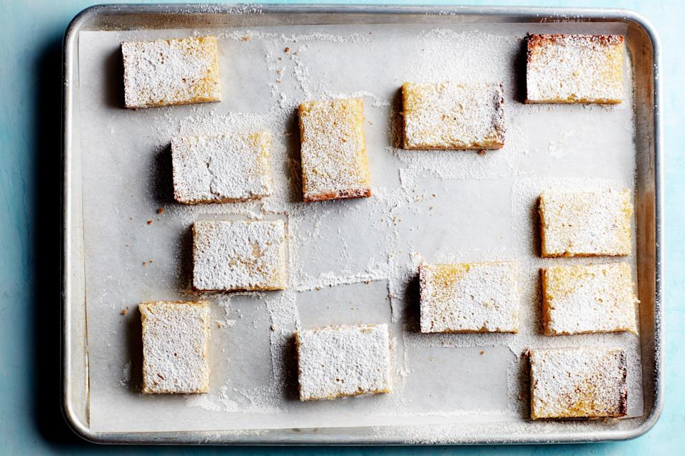 "Dust these bars with powdered sugar just before you plan to serve them—if left for too long, the sugar will be absorbed into the tangy lemon filling. <a href=""https://www.epicurious.com/recipes/food/views/gluten-free-lemon-bars?mbid=synd_yahoo_rss"" rel=""nofollow noopener"" target=""_blank"" data-ylk=""slk:See recipe."" class=""link rapid-noclick-resp"">See recipe.</a>"