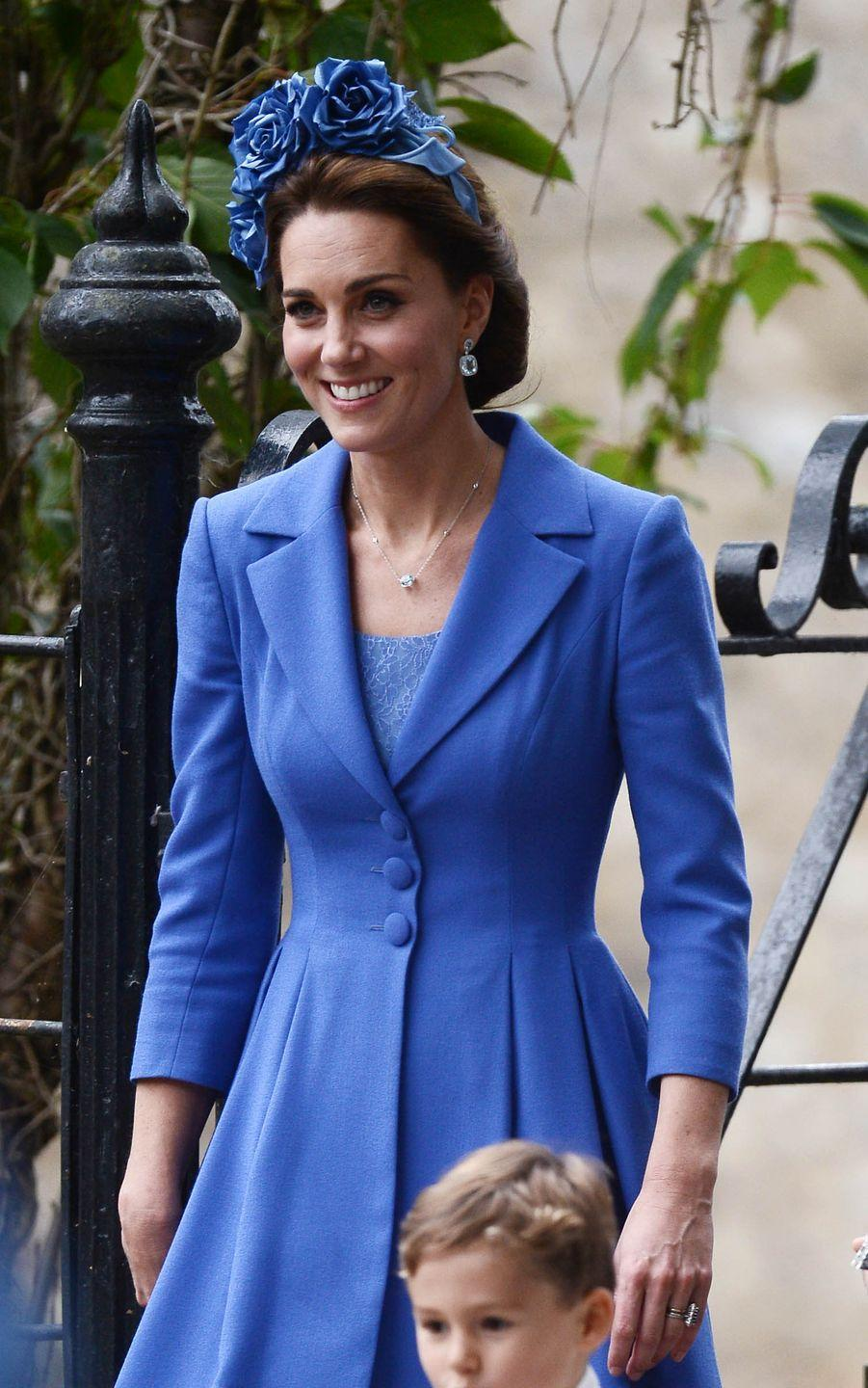 """<p>Kate attended <a href=""""https://www.townandcountrymag.com/society/tradition/a23398732/prince-george-princess-charlotte-sophie-carter-wedding/"""" rel=""""nofollow noopener"""" target=""""_blank"""" data-ylk=""""slk:the wedding of her close friend"""" class=""""link rapid-noclick-resp"""">the wedding of her close friend</a>, Sophie Carter, wearing a bespoke royal blue coat and dress by Catherine Walker. <a href=""""https://www.townandcountrymag.com/society/tradition/g10314690/kate-middleton-fashion-royal-tour-2017/"""" rel=""""nofollow noopener"""" target=""""_blank"""" data-ylk=""""slk:The Duchess first wore this look"""" class=""""link rapid-noclick-resp"""">The Duchess first wore this look</a> while on a royal tour of Poland and Germany last year. </p>"""