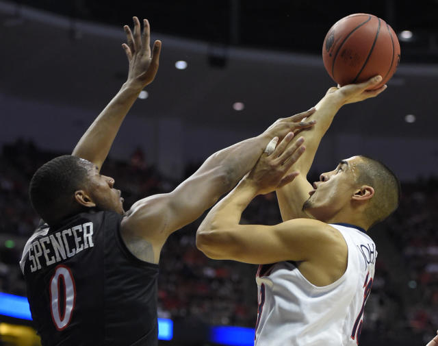 San Diego State forward Skylar Spencer (0) defends agasint Arizona guard Nick Johnson (13) during the first half of a regional semifinal in the NCAA men's college basketball tournament, Thursday, March 27, 2014, in Anaheim, Calif. (AP Photo/Mark J. Terrill)