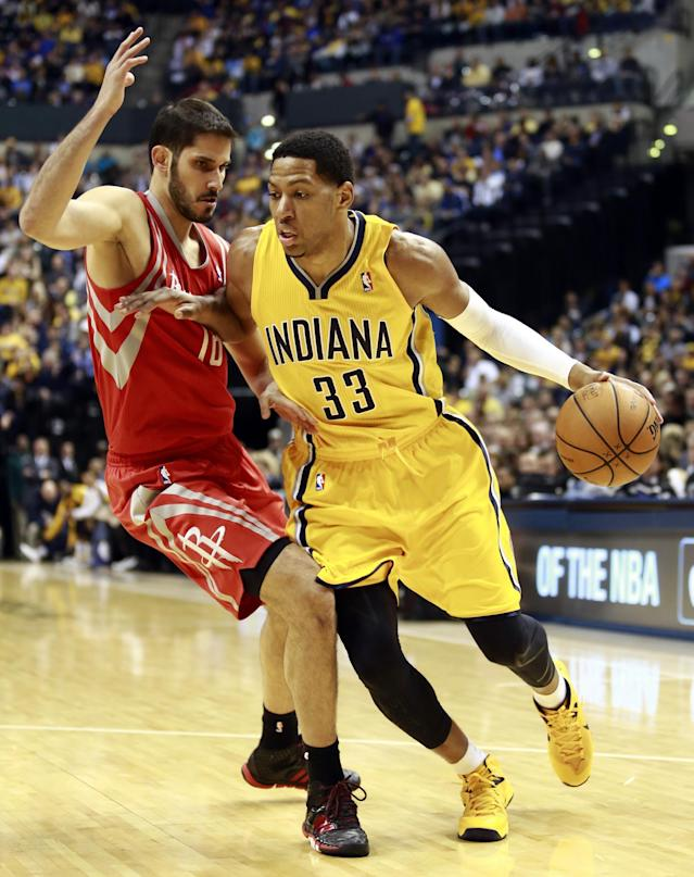 Indiana Pacers forward Danny Granger (33) pushes his way around Houston Rockets forward Omri Casspi in the second half of an NBA basketball game in Indianapolis, Friday, Dec. 20, 2013. (AP Photo/R Brent Smith)