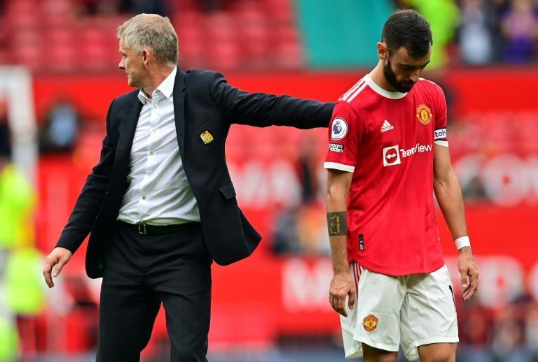 Bruno Fernandes (right)missed a late penalty in Manchester United's 1-0 defeat to Aston Villa (AFP/Paul ELLIS)