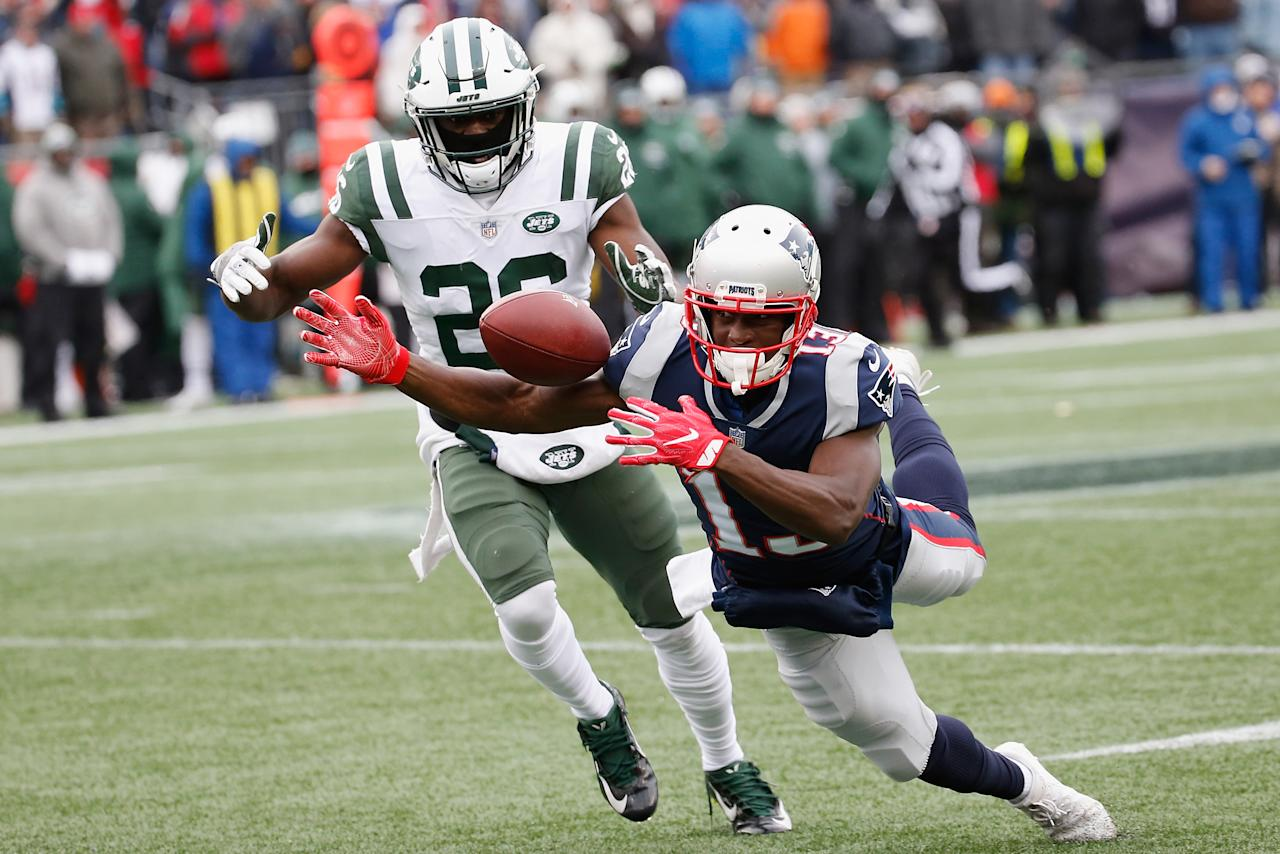 <p>Phillip Dorsett #13 of the New England Patriots attempts to make a reception as he is defended by Marcus Maye #26 of the New York Jets during the first half at Gillette Stadium on December 31, 2017 in Foxboro, Massachusetts. (Photo by Jim Rogash/Getty Images) </p>