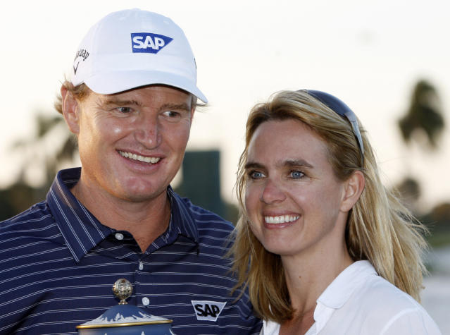 File - in this Sunday, March 14, 2010 file photo. Ernie Els and his wife Lieztl pose for photographers during the trophy ceremony at the CA Championship golf tournament in Doral, Fla. Els says he is considering cutting his golf schedule even more to spend time with his family, it was announced on Thursday, Dec. 5, 2103. The four-time major winner has already slowed down over the past few years, playing 19 tournaments on the PGA Tour and only seven European Tour events last season. (AP Photo/Alan Diaz, File)