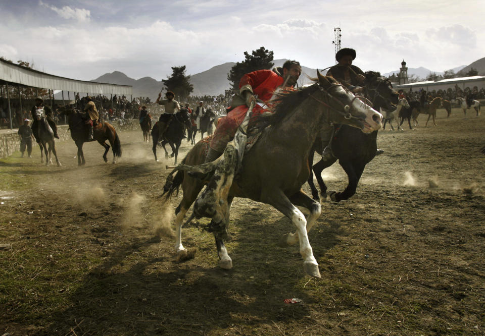FILE - In this March 21, 2006 file photo, men play the traditional game Buzkashi in Kabul, Afghanistan, in a special match held as part of celebrations for the New Year. According the solar calendar used in Afghanistan, the year is 1385. (AP Photo/David Guttenfelder, File)