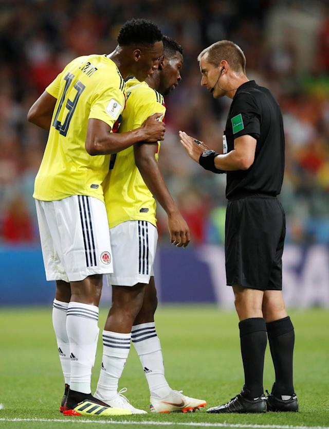 Referee Mark Geiger tells Colombia's Jefferson Lerma and Yerry Mina about the joys of Bournemouth