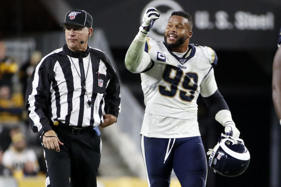 Los Angeles Rams defensive tackle Aaron Donald (99) makes his case to an official during the second half of an NFL football game against the Pittsburgh Steelers in Pittsburgh, Sunday, Nov. 10, 2019. (AP Photo/Don Wright)