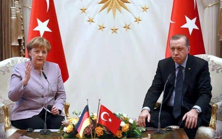 Recep Tayyip Erdogan with Angela Merkel at the Presidential Palace in Ankara in February, 2017 - AFP