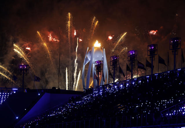 <p>Fireworks explode over the Olympic flame during the closing ceremony of the 2018 Winter Olympics in Pyeongchang, South Korea, Sunday, Feb. 25, 2018. (AP Photo/Michael Probst) </p>