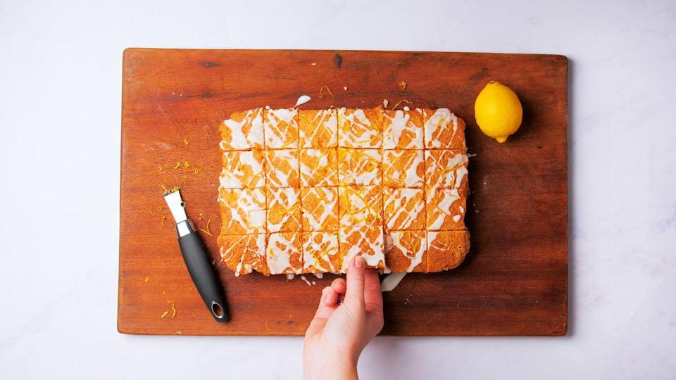 """<p>This simple, classic cake is a perennial favourite and is perfect for feeding a crowd or whipping up for a bakesale.</p><p><strong>Recipe: <a href=""""https://www.goodhousekeeping.com/uk/food/recipes/a29316068/lemon-drizzle-traybake/"""" rel=""""nofollow noopener"""" target=""""_blank"""" data-ylk=""""slk:Easy Lemon Drizzle Traybake"""" class=""""link rapid-noclick-resp"""">Easy Lemon Drizzle Traybake</a></strong></p>"""