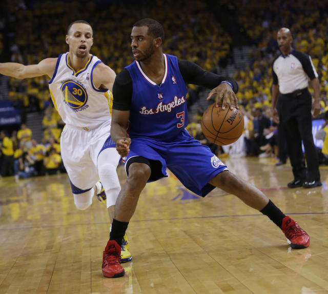 Los Angeles Clippers' Chris Paul (3) dribbles next to Golden State Warriors' Stephen Curry (30) during the first half in Game 4 of an opening-round NBA basketball playoff series on Sunday, April 27, 2014, in Oakland, Calif. (AP Photo/Marcio Jose Sanchez)