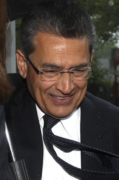 Rajat Gupta enters a federal courthouse in New York, Monday, May 21, 2012. Prosecutors will try to convince a jury that an intercepted call shows Gupta was providing inside tips that gave Raj Rajaratnam an illegal edge in massive stock maneuvers. Defense lawyers say they'll argue Gupta was a straight-shooter who only shared public information with the billionaire hedge fund boss, as devoted to raising money for charity as to Goldman's bottom line. Jury selection is scheduled to begin Monday in federal court in Manhattan. The trial is scheduled to last up to four weeks. (AP Photo/Seth Wenig)