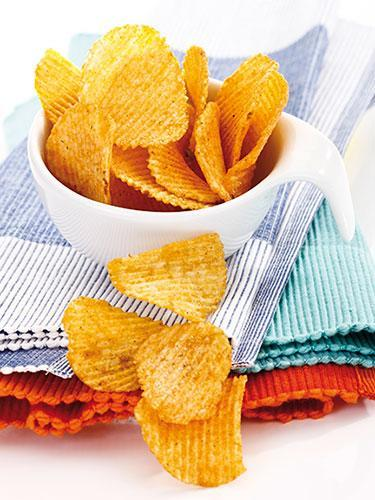 """<div class=""""caption-credit"""">Photo Credit: Getty Images</div><div class=""""caption-title"""">Potato Chips</div><p> Not only can all of that sodium cause dehydration, but it can also prompt kids to quench their chip-spurred thirst with sugary drinks, says Johnson. Plus, chips are high in fat. <br> <b>Smart swap:</b> Grilled corn. """"An ear of sweet corn on the cob is a good source of fiber,"""" says Crandall. Fiber is important for kids year-round, but summer schedules mean kids get less of it, and it's necessary for optimum gastrointestinal health. How much fiber does your small fry need? The Academy of Nutrition and Dietetics suggests adding five to your child's age (if he's between 3 and 18). For a calcium boost on top of the fiber fix, roll an ear of grilled corn in a bit of shredded sharp Cheddar or Parmesan cheese. </p> <br><p>Also on Woman's Day:</p><a href=""""http://www.womansday.com/health-fitness/diet-weight-loss/20-ways-to-burn-more-fat-1654?link=rel&dom=yah_life&src=syn&con=blog_wd&mag=wdy"""" rel=""""nofollow noopener"""" target=""""_blank"""" data-ylk=""""slk:20 Ways To Burn More Fat"""" class=""""link rapid-noclick-resp"""">20 Ways To Burn More Fat</a><a href=""""http://www.womansday.com/health-fitness/conditions-diseases/bad-habits-that-are-good-for-you?link=rel&dom=yah_life&src=syn&con=blog_wd&mag=wdy"""" rel=""""nofollow noopener"""" target=""""_blank"""" data-ylk=""""slk:9 Bad Habits That Are Good For You"""" class=""""link rapid-noclick-resp"""">9 Bad Habits That Are Good For You</a>"""