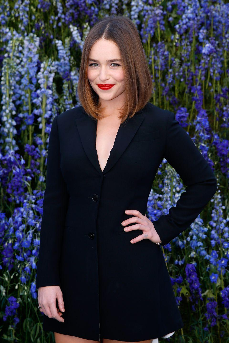 <p>When she isn't walking through fire or plotting her claim to the Iron Throne on <em>Game of Thrones</em>, Emilia Clarke wears her natural brunette hair color. </p>