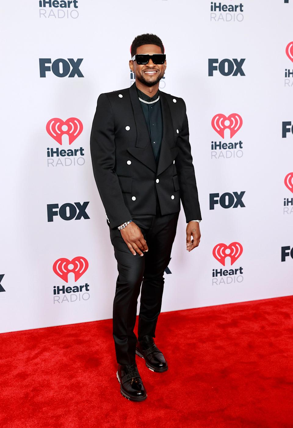 As host for the night, Usher looked sharp as ever in a black suit with a deep green shirt. The shades are the perfect pairing for a super sleek look.