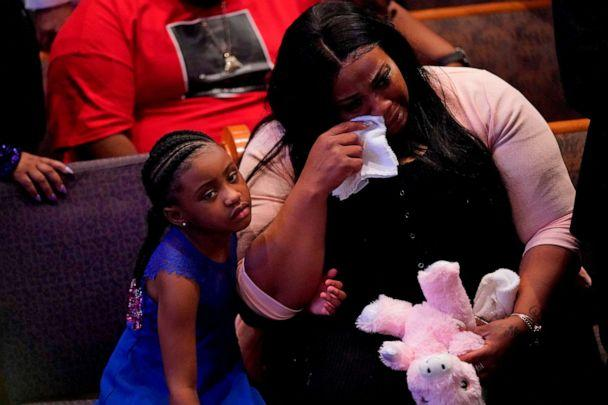 PHOTO: Gianna Floyd, the daughter of George Floyd, sits with Roxie Washington as they attend the funeral service for George Floyd at The Fountain of Praise church, June 9, 2020, in Houston. (David J. Phillip/Pool/AFP via Getty Images)
