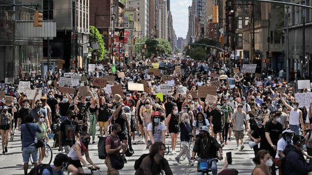 PHOTO: Protesters march through the streets of Manhattan, New York, June 7, 2020, against police brutality after the death in police custody in Minneapolis of George Floyd. (Seth Wenig/AP)