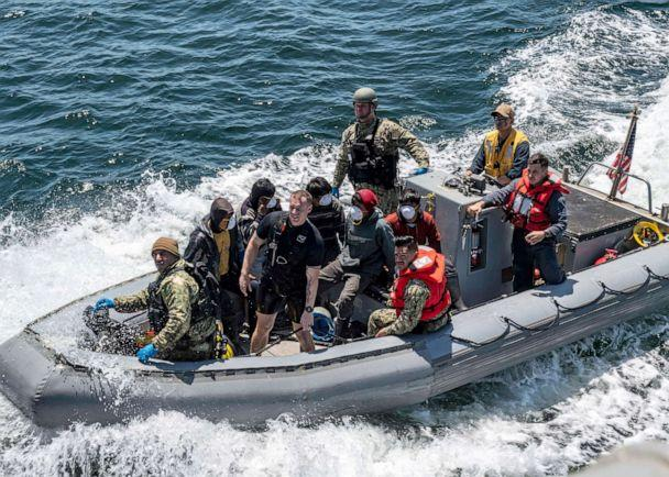 PHOTO: A boarding team from the Arleigh Burke-class guided-missile destroyer USS Michael Murphy bring mariners rescued from a fishing vessel in distress aboard Michael Murphy for aid, July 24, 2019. (Justin R. Pacheco/U.S. Navy)