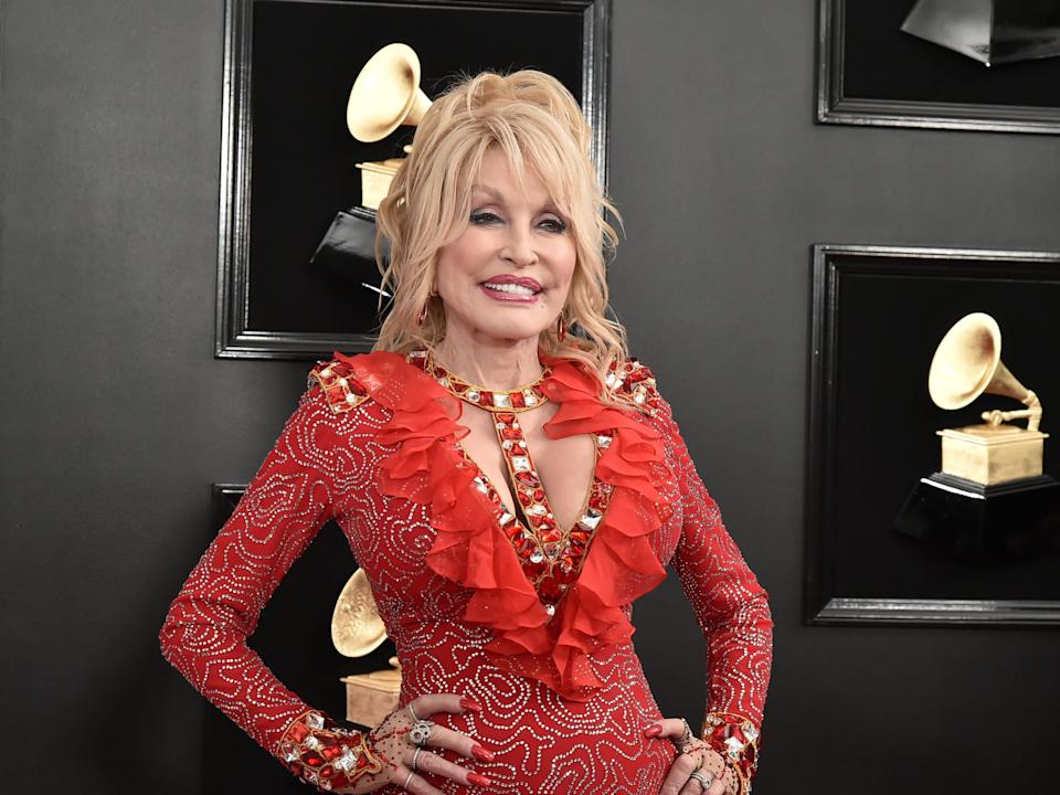 Dolly Parton at the Grammys in a red dress.
