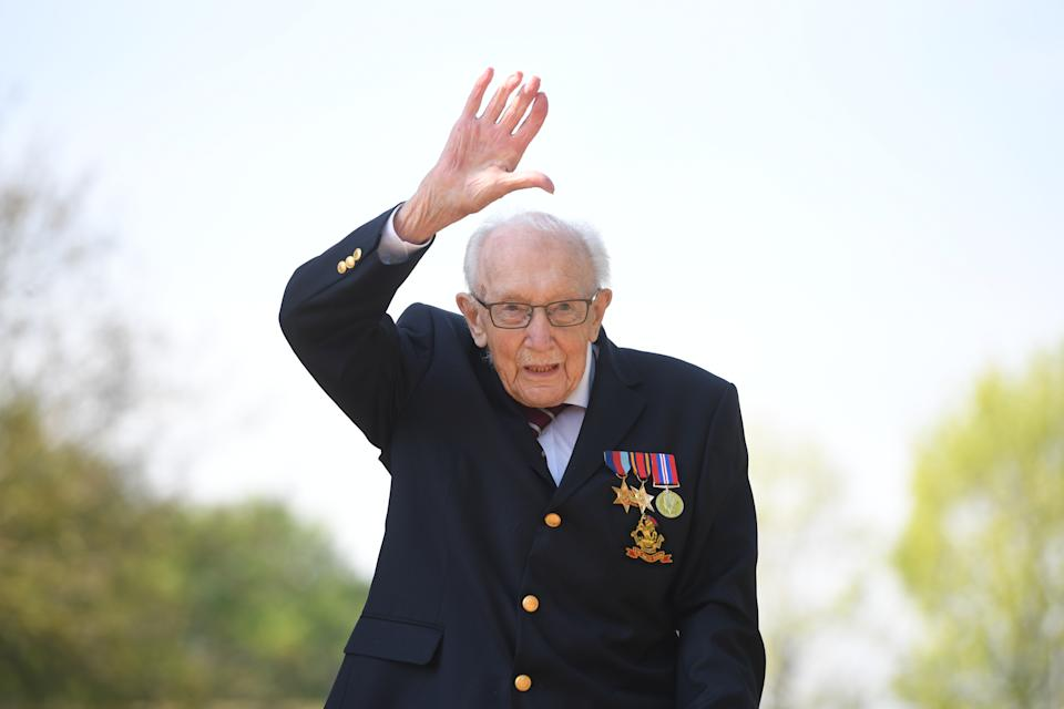 File photo dated 16/04/2020 of the then 99-year-old war veteran Captain Tom Moore at his home in Marston Moretaine, Bedfordshire, after he achieved his goal of 100 laps of his garden. Captain Sir Tom Moore has died at the age of 100 after testing positive for Covid-19, his daughters Hannah and Lucy said in a statement. Issue date: Tuesday February 2, 2021.