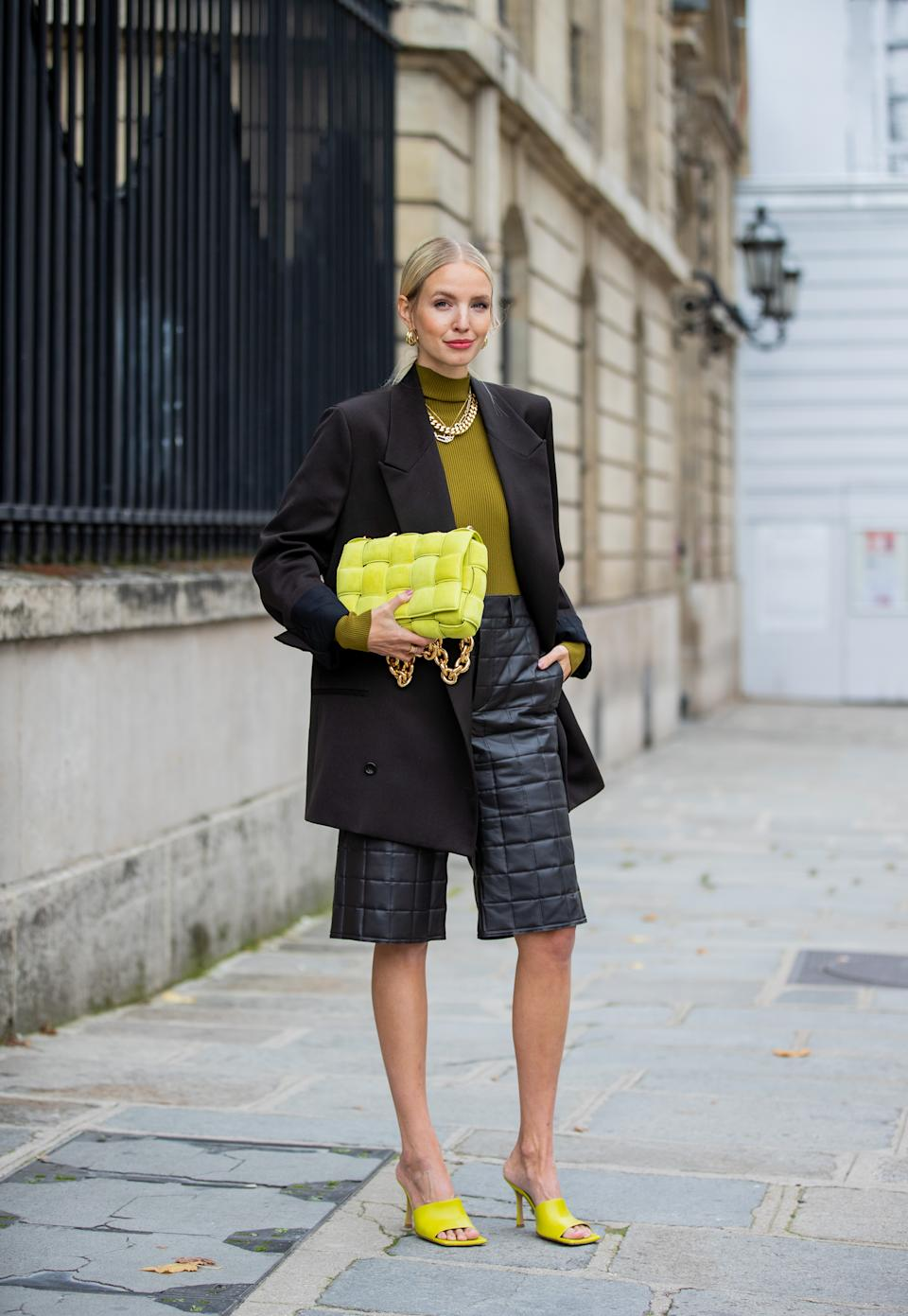 PARIS, FRANCE - OCTOBER 08: Leonie Hanne is seen wearing black blazer Maison Margiela, neon yellow bag Bottega Veneta, shorts Bottega, shoes Bottega Veneta, green turtleneck during a Street Style Fashion Photo Session on October 08, 2020 in Paris, France. (Photo by Christian Vierig/Getty Images)