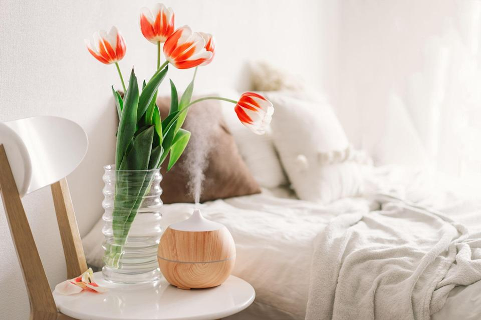 """<p>For many, our homes have become all-in-one spaces this past year and it's understandable that we'd like to make it as comfortable and relaxing as possible. Scent plays a part in that. Whether a particular smell triggers happy memories or soothes your nerves, aromatherapy is one popular <a href=""""https://www.oprahdaily.com/life/health/g25939272/self-care-tips/"""" rel=""""nofollow noopener"""" target=""""_blank"""" data-ylk=""""slk:self-care approach"""" class=""""link rapid-noclick-resp"""">self-care approach</a> to relaxation. </p><p>""""The best way to reduce anxiety and stress with essential oils is through inhalation,"""" as clinical aromatherapist and nursing instructor <a href=""""https://www.augusta.edu/faculty/directory/view.php?id=DLANGLEY"""" rel=""""nofollow noopener"""" target=""""_blank"""" data-ylk=""""slk:Dawn Langley-Brady"""" class=""""link rapid-noclick-resp"""">Dawn Langley-Brady</a>, RN, <a href=""""https://www.oprahdaily.com/beauty/skin-makeup/a25655971/essential-oils-for-stress/"""" rel=""""nofollow noopener"""" target=""""_blank"""" data-ylk=""""slk:previously told Oprah Daily"""" class=""""link rapid-noclick-resp"""">previously told Oprah Daily</a>. Essential oil diffusers are a convenient method to release the scent of your favorite oils and infuse the air while providing a perceived sense of calm—many of them also serve as beautiful decor pieces.</p><p>""""There's a huge variety of diffusers available now, which run the gamut from low-maintenance to innovative electric versions to smart and Alexa-compatible,"""" says Oprah Daily's Market Director, Rae Ann Herman.</p><p>Classic reed diffusers are a good standby, she explains, especially because they don't require any effort—just leave them in their vessel and they'll remain fragrant for months. Consider ultrasonic types, which blend water and essential oils together to dispense a fine mist, as a hybrid between humidifier and diffuser. On the other hand, nebulizing models function with oil alone and deliver a stronger aroma, making them ideal for larger rooms. The latter two diffusers of"""