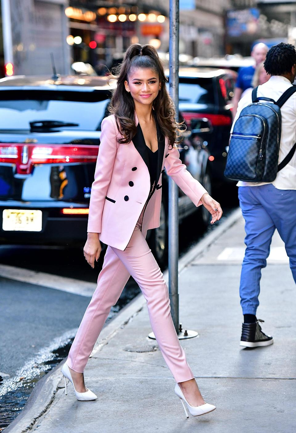 <p>Zendaya opted for a candy-hued two-piece suit for an appearance on Good Morning America. <em>[Photo: Getty]</em> </p>