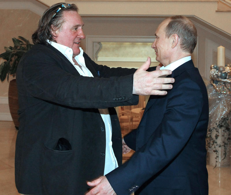 French actor Gerard Depardieu, left, greets Russian President Vladimir Putin after his arrival late Saturday, Jan. 5, 2013, at the president's residence in Sochi, the host city of the 2014 Winter Olympics. Depardieu has received a Russian passport after flying to Russia for a late night dinner with Putin. Depardieu sought Russian citizenship as part of his battle against a proposed super tax on millionaires in France, and Putin granted his request last week. (AP Photo/RIA-Novosti, Mikhail Klimentyev, Presidential Press Service)