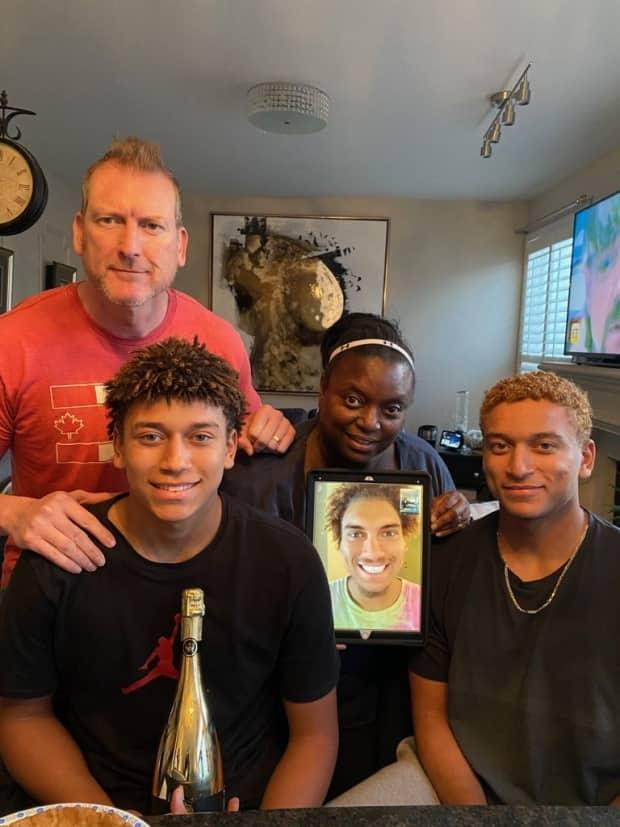 The Naylor family: Parents Chris and Jenice, brothers Myles and Noah, with Josh in display.