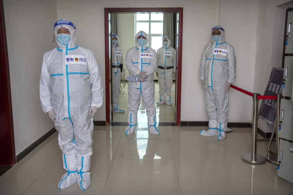 Security officers in protective suits stand near the entrance checkpoint to the inmate detention area at the Urumqi No. 3 Detention Center in Dabancheng in western China's Xinjiang Uyghur Autonomous Region on April 23, 2021. Urumqi No. 3, China's largest detention center, is twice the size of Vatican City and has room for at least 10,000 inmates. (AP Photo/Mark Schiefelbein)