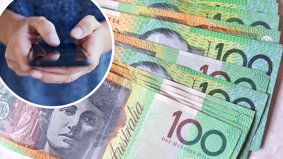 Image of $100 notes and person holding mobile phone
