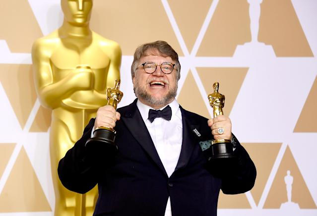 Guillermo del Toro holds his trophies for Best Picture and Best Director. (Frazer Harrison via Getty Images)