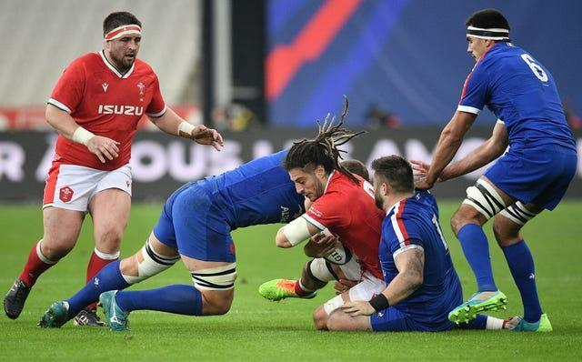 Wales' Josh Navidi is tackled during the Six Nations match against France