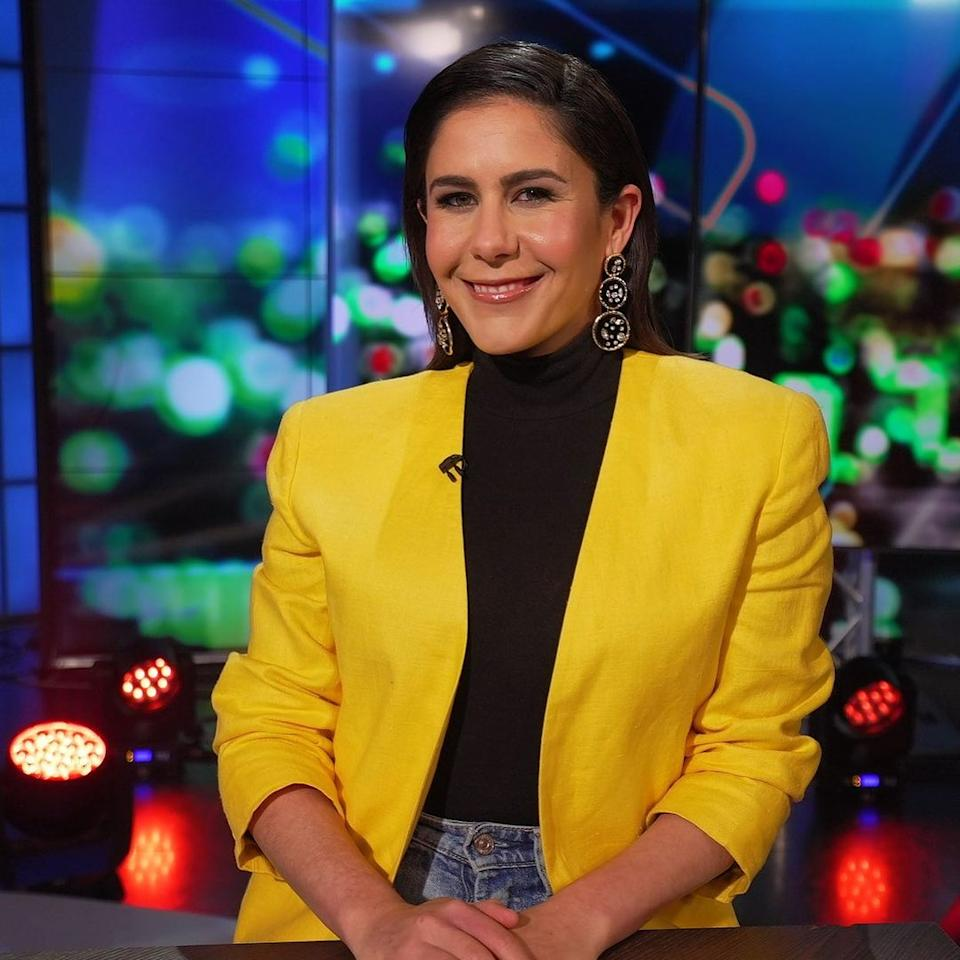 The Project host Jan Fran wearing a yellow jacket on set. Photo: Channel 10.