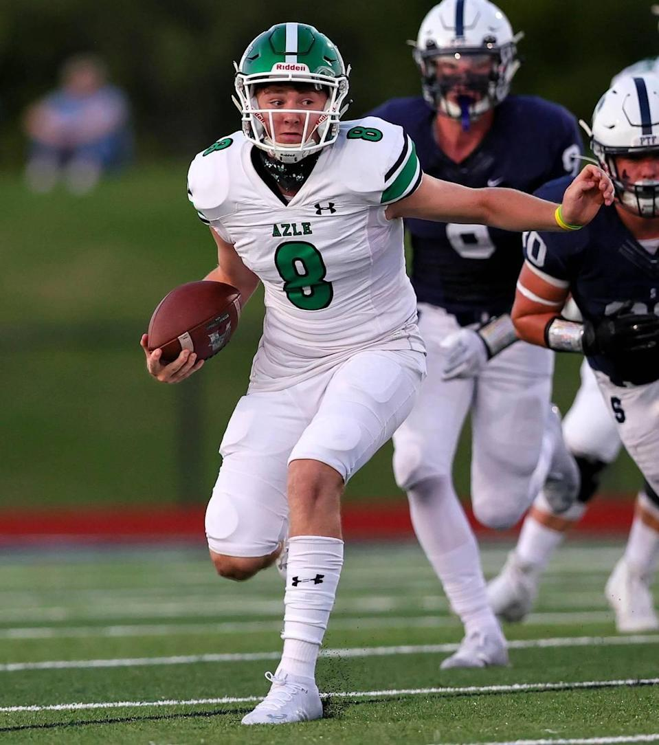 Azle quarterback Chris Lee (8) looks for room to run against All Saints during the first half, Friday night, September 25, 2020 played at All Saints High School in Fort Worth, TX. (Steve Nurenberg Special to the Star-Telegram)