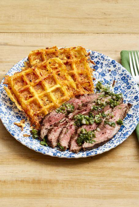 """<p>These crispy, cheesy hash browns are made right in your waffle iron. How's that for a creative and delicious side?</p><p><strong><a href=""""https://www.thepioneerwoman.com/food-cooking/recipes/a32475948/flank-steak-with-cheesy-waffle-hash-browns-recipe/"""" rel=""""nofollow noopener"""" target=""""_blank"""" data-ylk=""""slk:Get the recipe."""" class=""""link rapid-noclick-resp"""">Get the recipe.</a></strong></p><p><strong><a class=""""link rapid-noclick-resp"""" href=""""https://go.redirectingat.com?id=74968X1596630&url=https%3A%2F%2Fwww.walmart.com%2Fip%2FHamilton-Beach-Belgian-Style-Waffle-Baker-Model-26020%2F16503561&sref=https%3A%2F%2Fwww.thepioneerwoman.com%2Ffood-cooking%2Fmeals-menus%2Fg32933285%2Fcomfort-food-recipes%2F"""" rel=""""nofollow noopener"""" target=""""_blank"""" data-ylk=""""slk:SHOP WAFFLE IRONS"""">SHOP WAFFLE IRONS</a></strong></p>"""
