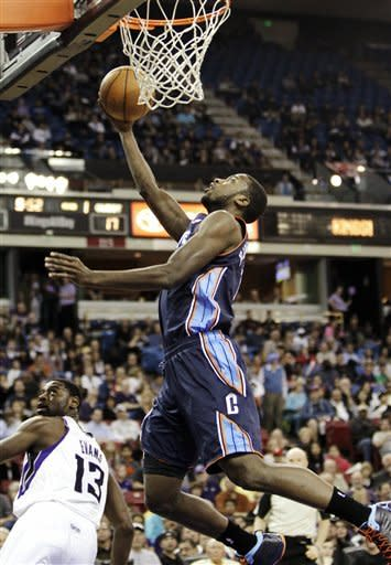 Charlotte Bobcats forward Michael Kidd-Gilchrist drives to the basket past Sacramento Kings guard Tyreke Evans (13) during the first quarter of an NBA basketball game in Sacramento, Calif., Sunday, March 3, 2013. (AP Photo/Rich Pedroncelli)